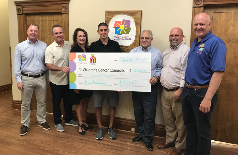 DMAAR Golf Check to Childrens Cancer Connection